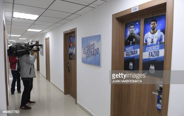 Journalists take photographs of the doors of the Argentina's football players' rooms at Argentina's base camp in Bronnitsy south of Moscow on June 8...