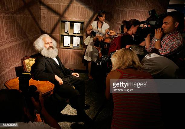 Journalists take pictures of a wax model of Karl Marx in the Berlin Branch of Madame Tussauds on July 3 in Berlin Germany The famous Madame Tussauds...