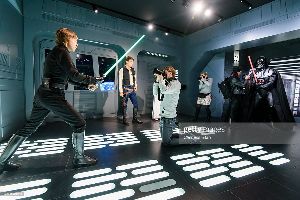 Journalists take pictures of wax figures of the actors (L-R) Mark Hamill as the Star Wars character Luke Skywalker, Harrison Ford as the Star Wars character Han Solo, Carrie Fisher as the Star Wars character Leia Organa, a Stormtrooper and the Star Wars charakter Darth Vader displayed on the occasion of Madame Tussauds Berlin Presents New Star Wars Wax Figures at Madame Tussauds on May 8, 2015 in Berlin, Germany.
