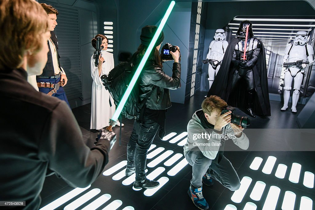Journalists take pictures of wax figures of the actors (L-R) Mark Hamill as the Star Wars character Luke Skywalker, Harrison Ford as the Star Wars character Han Solo, Carrie Fisher as the Star Wars character Leia Organa, a Stormtrooper, the Star Wars charakter Darth Vader and another Stormtrooper displayed on the occasion of Madame Tussauds Berlin Presents New Star Wars Wax Figures at Madame Tussauds on May 8, 2015 in Berlin, Germany.