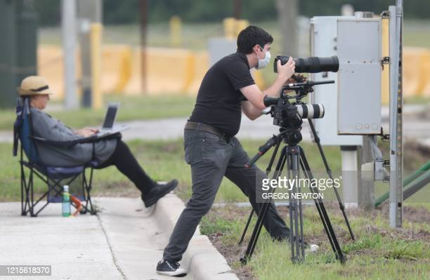 Journalists take positions and cover preparations on launch day at the Kennedy Space Center in Florida on May 26 2020 A new era in space begins...