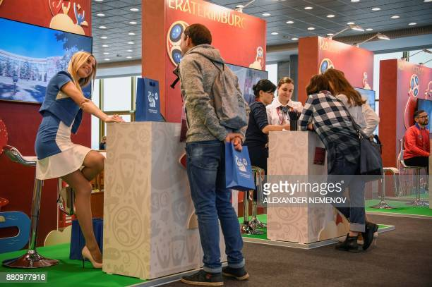 Journalists talk to volunteers at the FIFA World Cup 2018 Final Draw media centre at the State Kremlin Palace in downtown Moscow on November 28 2017...