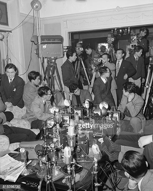 Journalists television and newsreel cameramen are shown waiting for Prime Minister Ichiro Hatoyama at his private residence in Tokyo after his...