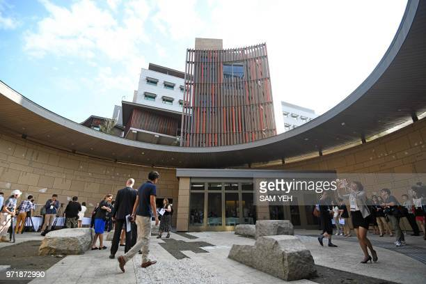 Journalists tour the new office complex of the American Institute in Taiwan during a dedication ceremony in Taipei on June 12 2018 Washington on June...