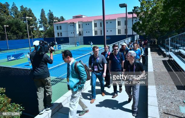 Journalists tour the University of California Los Angeles campus which will host the Athelete's village and provide training facilities for a number...