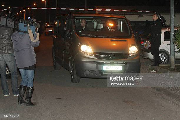 Journalists video record a van carrying the bodies of two local council employees and a bystander shot dead by a 78yearold French plumber before he...