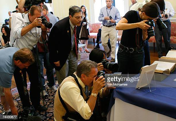 Journalists view a newly discovered letter written by Abraham Lincoln displayed at the National Archives June 7 2007 in Washington DC Lincoln's...