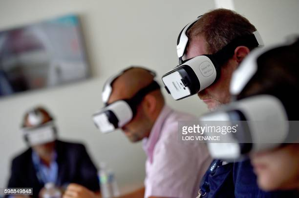 Journalists virtually visit the MSC Meraviglia giant cruise ship on September 2 2016 in SaintNazaire western France STX shipyard workers still have...