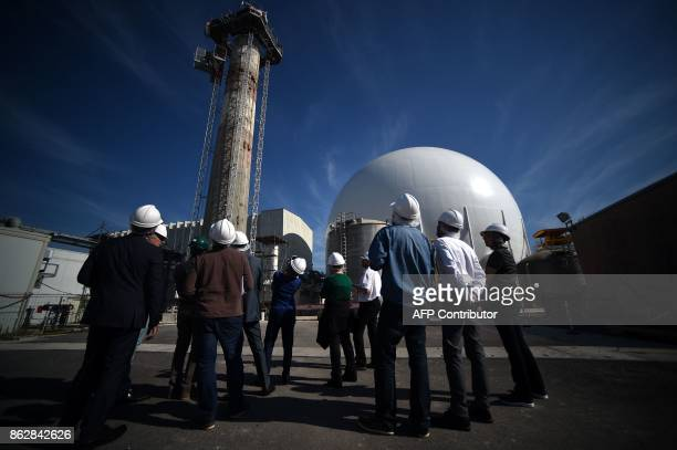 Journalists visit the Garigliano Nuclear Power Plant located at the outskirts of Sessa Aurunca, 160km southern Rome, on October 17, 2017. The French...