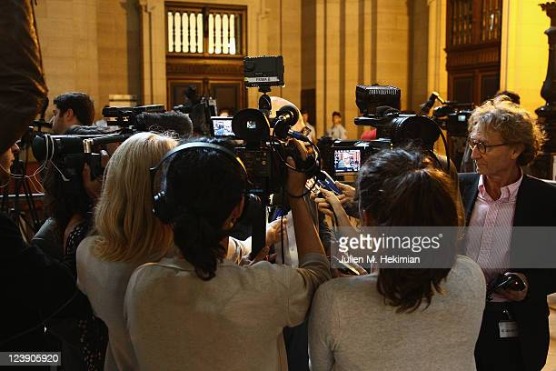 Journalists wait for the former President Jacques Chirac trial opening on September 5 2011 in Paris France The trial of former President Jacques...