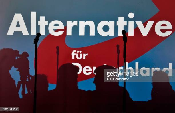 Journalists wait in front of a projection of a logo of the Alternative for Germany party prior to election night event in Berlin during the general...