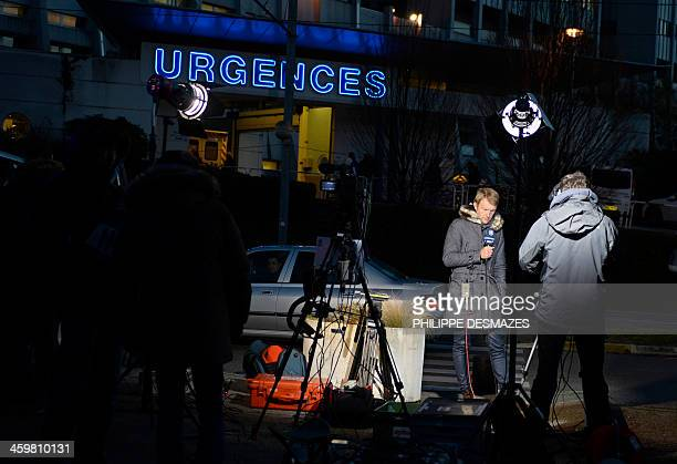 Journalists wait in front of the emergency services of the Centre Hospitalier Universitaire in Grenoble on December 30 where retired seventime German...