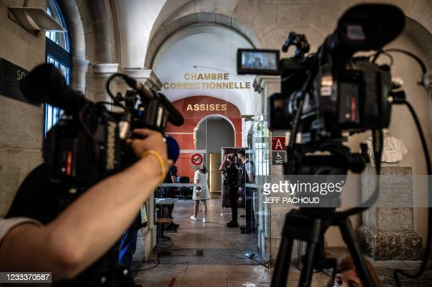 Journalists wait in front of the Valence courtroom on June 10, 2021 in the southern town of Valence before a 28-year-old man who slapped French...