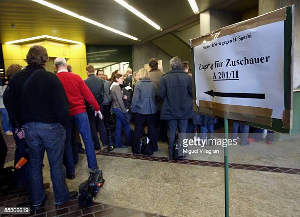 Journalists wait in line to go to the Helg Sgarbi trail at the country court on March 9 2009 in Munich Germany Helg Sgarbi has been charged with...