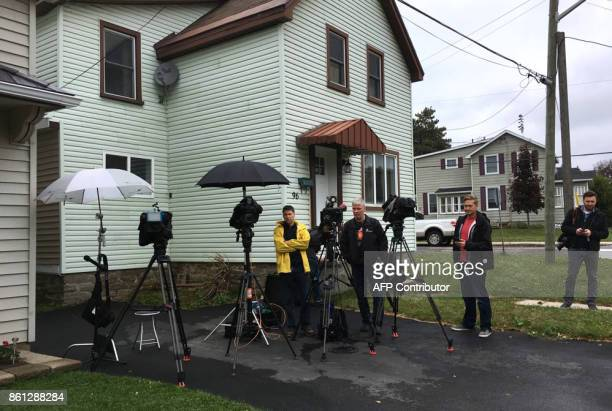 Journalists wait outside Canadian hostage Joshua Boyle's family home in Smiths Falls Ontario Canada on October 14 2017 Freed Canadian hostage Joshua...