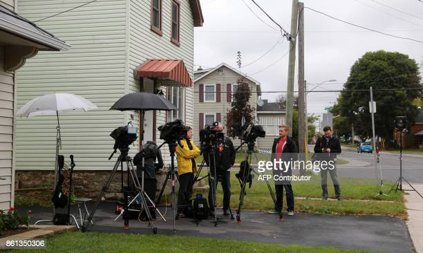 Journalists wait outside freed Canadian hostage Joshua Boyle's family home in Smiths Falls Ontario Canada on October 14 2017 Freed Canadian hostage...