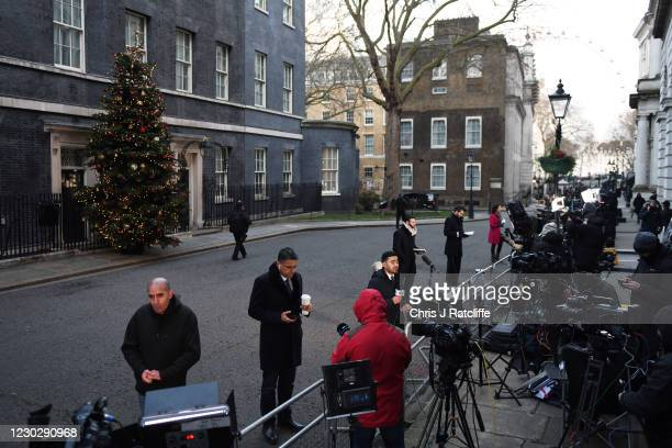 Journalists wait outside number 10 Downing Street as Prime Minister, Boris Johnson holds a press conference on reaching a Brexit trade deal on...