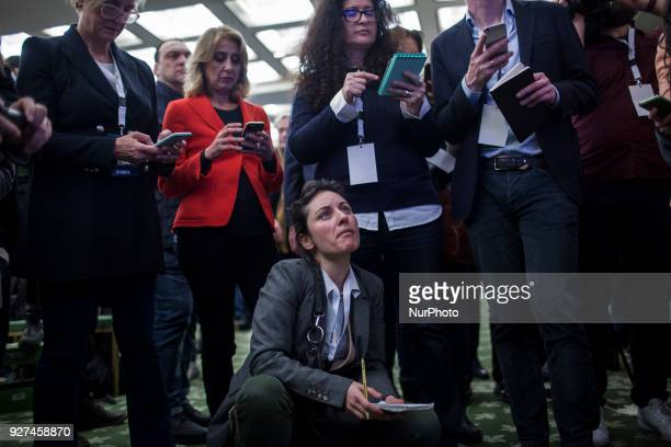 Journalists wait the first exit polls after the Italian general election at the headquarters of FiveStar Movement in Rome Sunday March 5 2018 The...