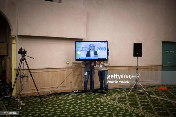 Journalists wait the first exit polls after the Italian general election on March 4 2018 in Rome Italy The economy and immigration are key factors in...