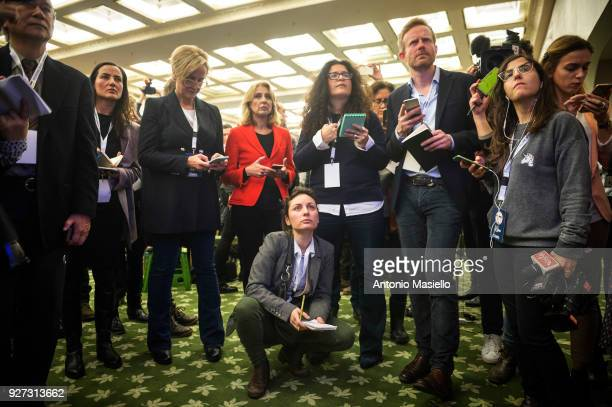 Journalists wait the first exit polls after the Italian general election on March 5 2018 in Rome Italy The economy and immigration are key factors in...