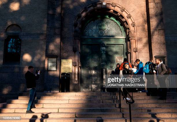 Journalists wait to enter the district court in Stockholm on September 19 where Frenchman JeanClaude Arnault is to appear accused of rape and sexual...