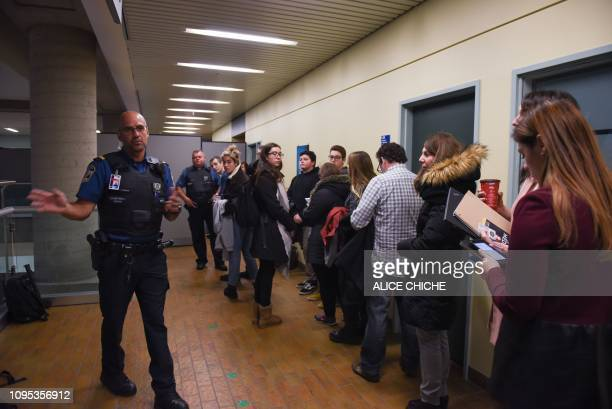 Journalists wait to pass security in the Quebec City Courthouse on February 8 2019 Canadian Alexandre Bissonnette will be sentenced on February 8 for...