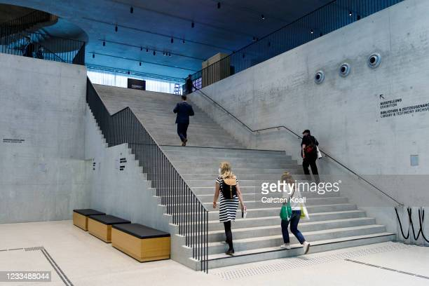 Journalists walk in the hall in the new Documentation Center for Displacement, Expulsion and Reconciliation on June 16, 2021 in Berlin, Germany. The...