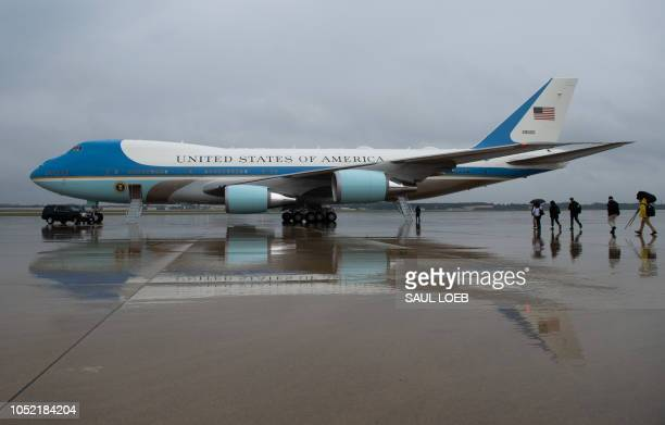 Journalists walk to board Air Force One prior to the departure of US President Donald Trump and First Lady Melania Trump from Joint Base Andrews in...