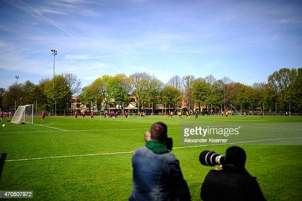 Journalists watch newly announced Head Coach Michael Frontzeck at a training session at HDIArena on April 21 2015 in Hanover Germany Frontzeck...