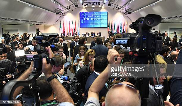 Journalists watch the opening of the 169th meeting of the Organization of the Petroleum Exporting Countries OPEC at OPEC headquarters in Vienna...