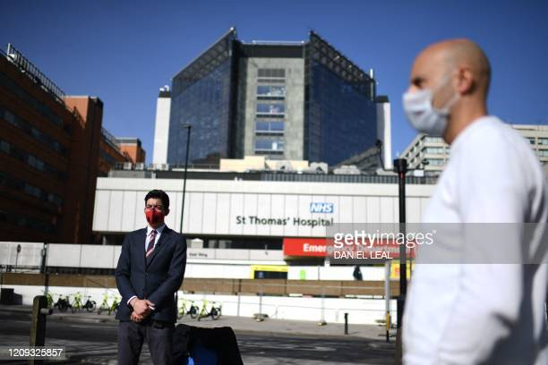 TOPSHOT Journalists wearing masks are seen outside St Thomas' Hospital in central London where Britain's Prime Minister Boris Johnson is in intensive...