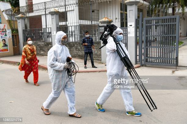 Journalists wearing protective suits as a preventive measure against the spread of covid-19 walking around Mugda Medical College Hospital. Bangladesh...