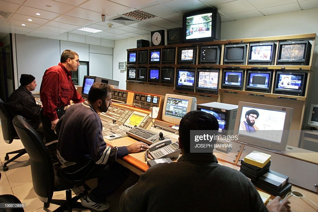 Journalists work 24 November 2004 at Al-Manar TV station studios in southern Beirut. The French public broadcasting regulator authorised 19 November the station, which is close to the Lebanese Shiite Muslim Hezbollah group, to transmit programmes within the European Union. The Al-Manar station, well known within the Arabic world, had committed itself in an agreement 'not to incite hatred, violence or discrimination based on race, sex, religion or nationality,' said the French Audiovisual Council.