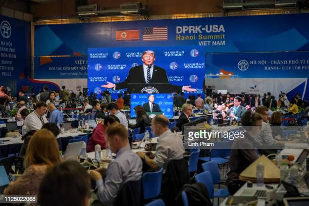 Journalists work at a media centre as the press conference by US President Donald Trump is telecasted following the second USNorth Korea summit on...