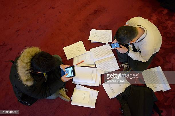 Journalists work before the opening ceremony of the National People's Congress at the Great Hall of the People in Beijing on March 5 2016 Chinas...