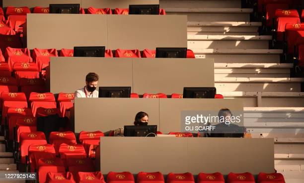 Journalists work during the UEFA Europa League last 16 second leg football match between Manchester United and Linzer ASK at Old Trafford in...