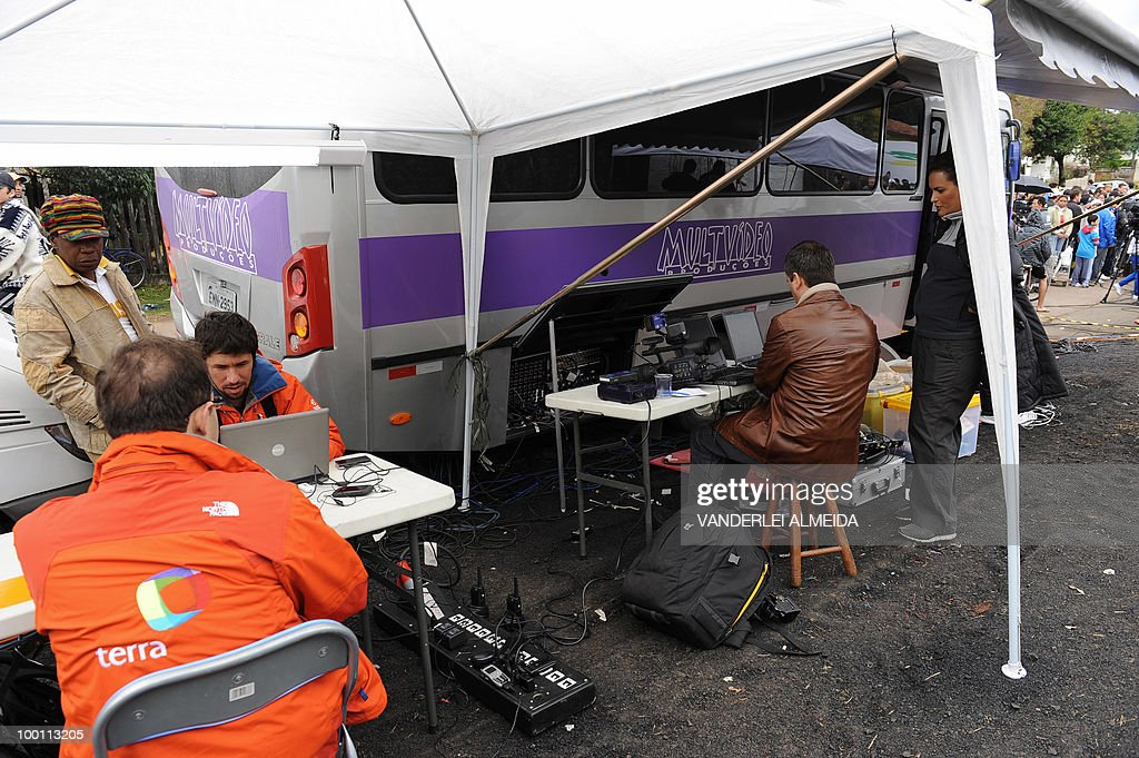 Journalists work in a tent located in front of the training center where the Brazilian football gets prepared for the FIFA World Cup South Africa-2010, in Curitiva on May 21, 2010.
