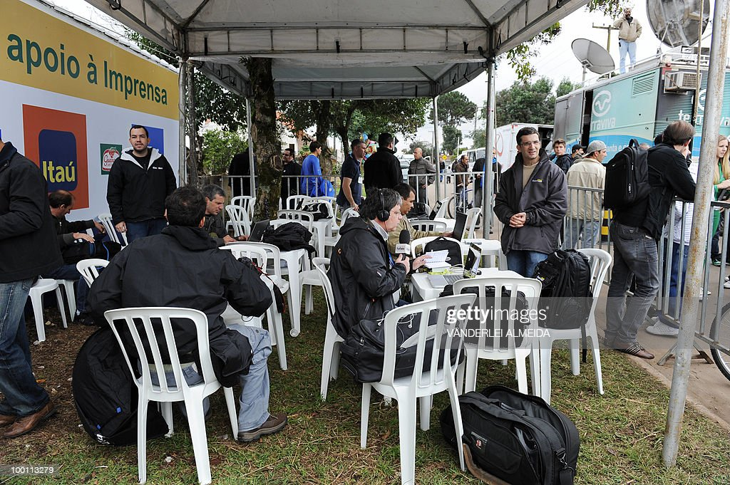 Journalists work in a tent located in fr