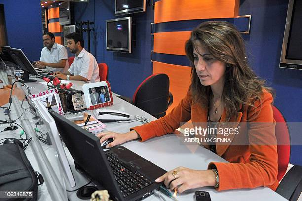 Journalists work in an office of the news channel headquarters on October 29 2010 in Rabat Morocco has suspended the operations of the Qatarbased...