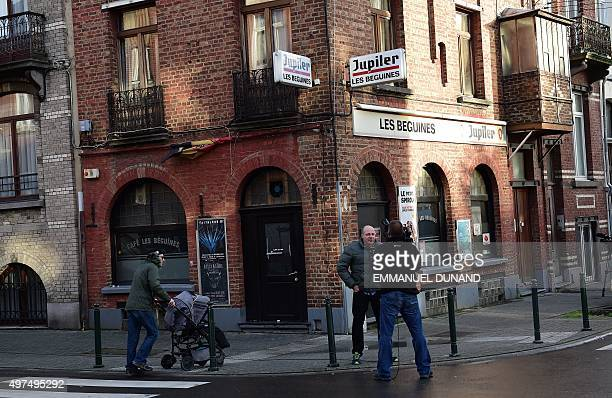 Journalists work in front of the bar Les Beguines owned by Brahim Abdeslam one of the suicide bombers implicated in the Paris attacks on November 17...