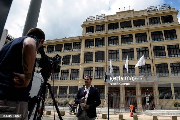 TV journalists work in front of the Fiat Chrysler Automobiles headquarters in former Fiat historic building 'Lingotto' On July 21 FCA board discuss...