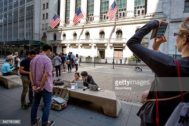Journalists work in front of the New York Stock Exchange in New York US on Friday June 24 2016 US stocks tumbled joining a worldwide selloff with the...