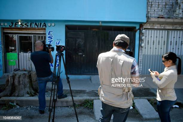 Journalists work in front the house where Juan Carlos and his wife Patricia alleged murderers of 20 women lived in the neighborhood of Jardinez de...