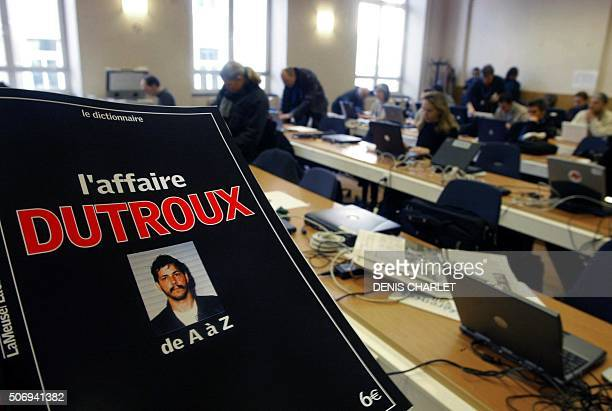 Journalists work in the press center at the Arlon courthouse 01 March 2004 on the opening day of the trial of Marc Dutroux accused of kidnapping and...