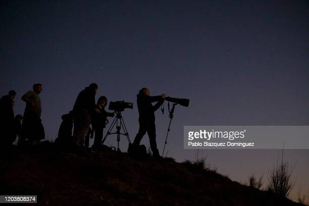 Journalists work on a hill after the emergency landing of an Air Canada flight at Adolfo Suarez MadridBarajas Airport on February 03 2020 in Madrid...