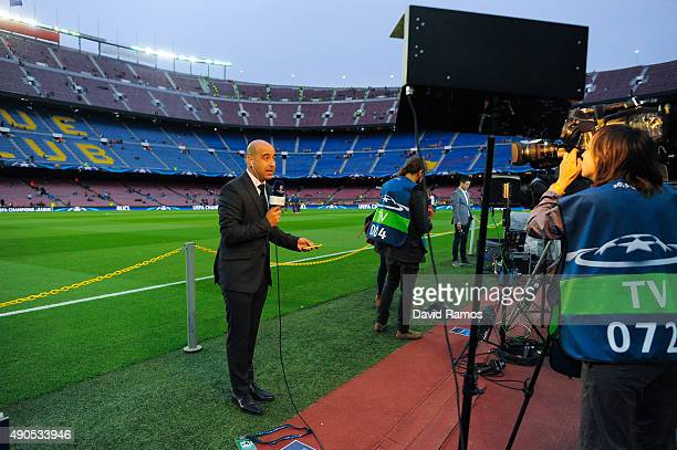 Journalists work on the pitch ahead of a UEFA Champions League Group E match between FC Barcelona and Bayer 04 Leverkusen on September 29 2015 in...