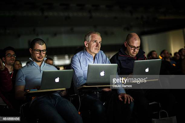 Journalists work on their Apple laptops as they attend to new Samsung Galaxy S6 unpacked during the Mobile World Congress 2015 March 1 2015 in...