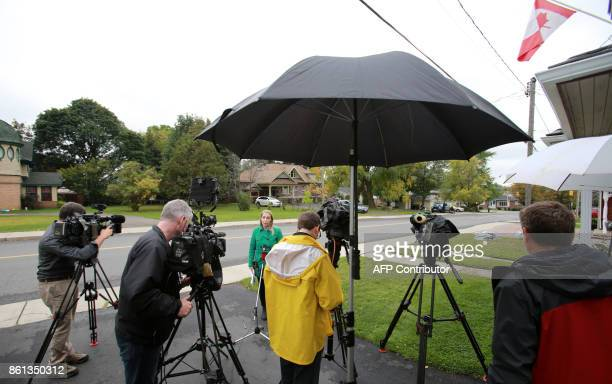 Journalists work outside freed Canadian hostage Joshua Boyle's family home in Smiths Falls Ontario Canada on October 14 2017 Freed Canadian hostage...