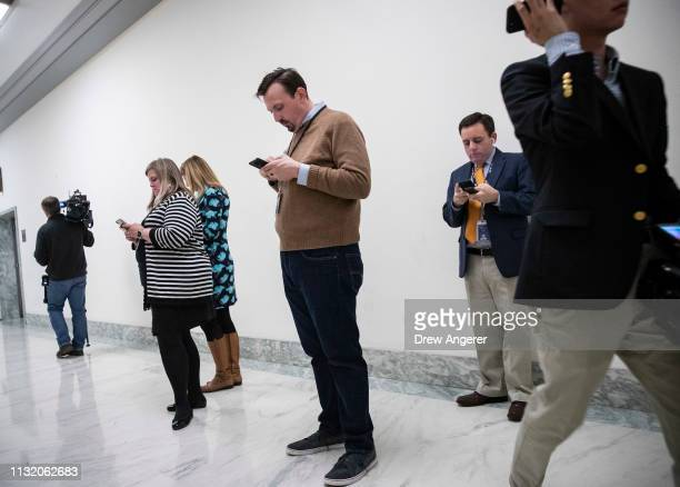 Journalists work outside of the House Judiciary Committee in the Rayburn House Office Building after the announcement that Special Counsel Robert...