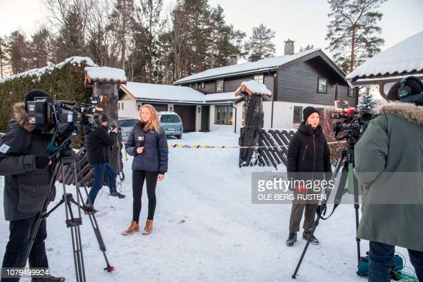 Journalists work outside of the house of Norwegian multimillionaire Tom Hagen in Fjellhamar East of Oslo on January 9 2019 as his wife AnneElisabeth...